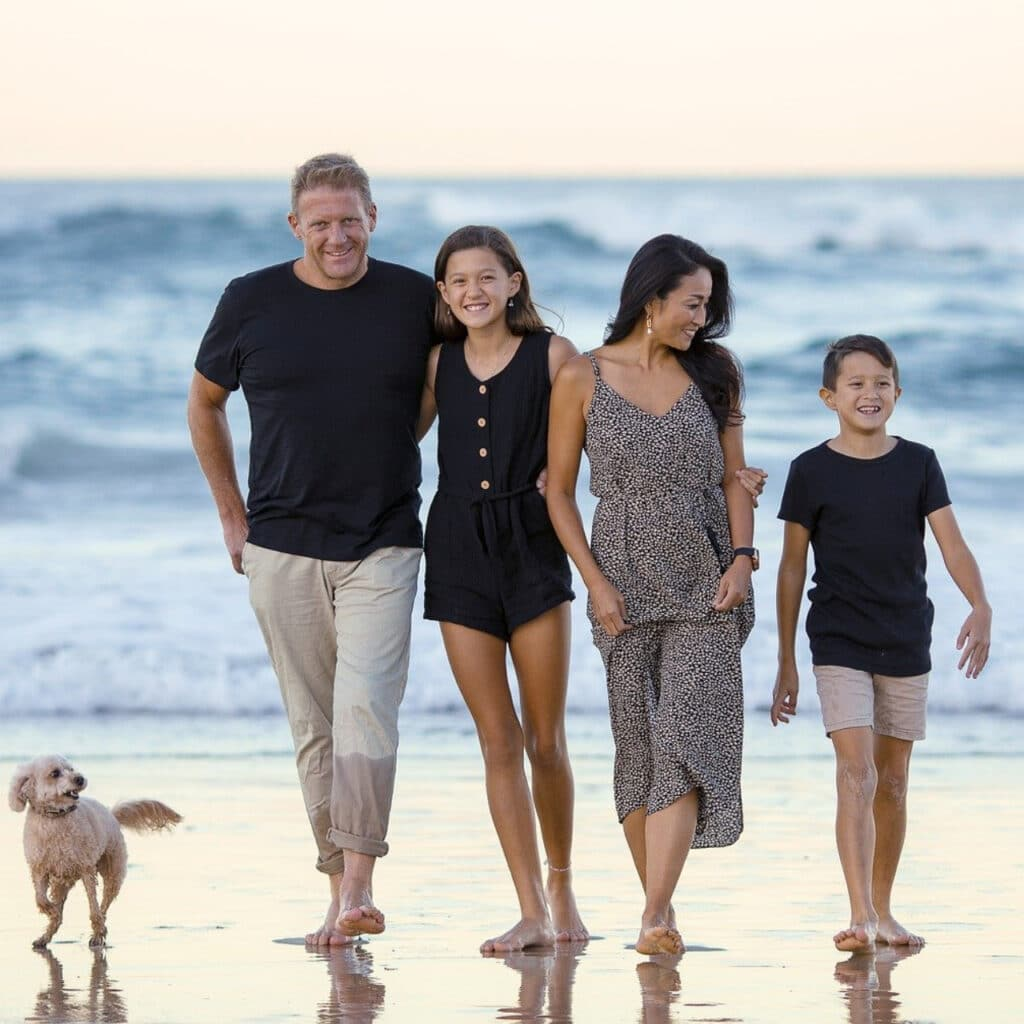 Photo of a happy family at the beach.