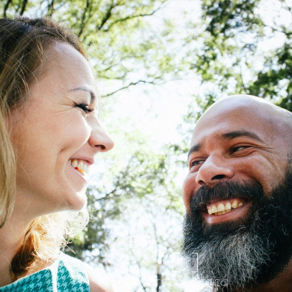 Photo of a couple smiling.