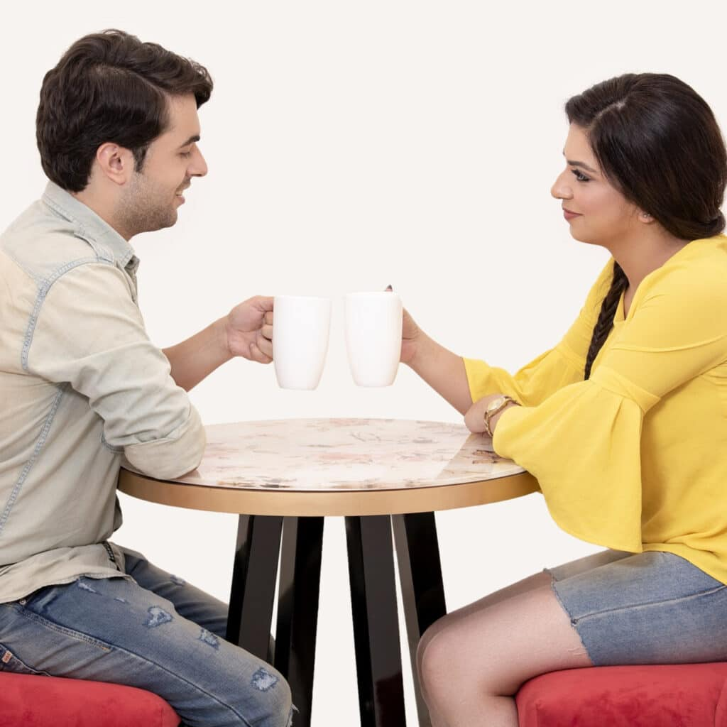 Photo of a couple having coffee together.