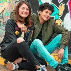 Photo of a smiling young couple.