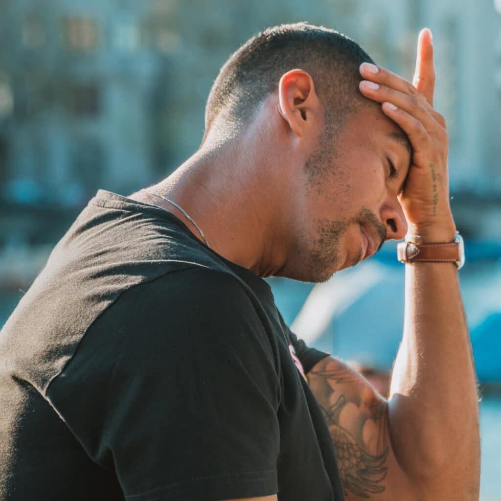 Photo of a sad man.