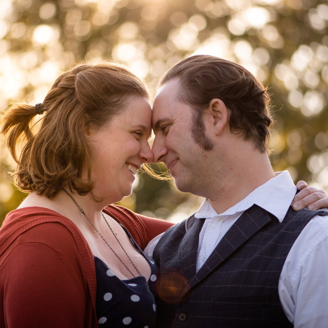 Photo of a couple face to face smiling.