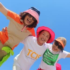 Photo of three women having fun.